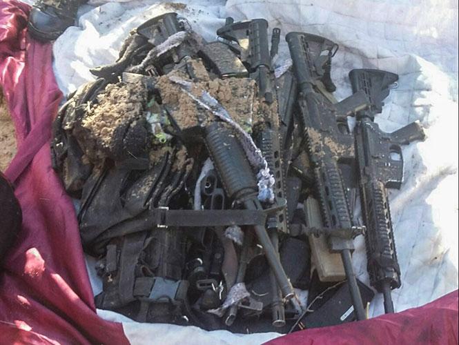 Detienen a siete con un arsenal, entre ellos barret calibre 50 y granadas 1452137