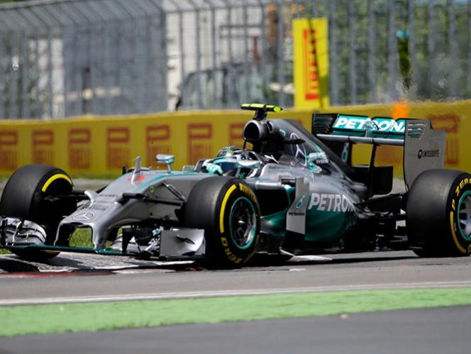 Rosberg obtiene la 'pole' en Canadá; 'Checo' en 13 (AP)