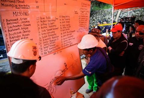 Buscan en Filipinas a decenas de personas sepultadas tras tifón