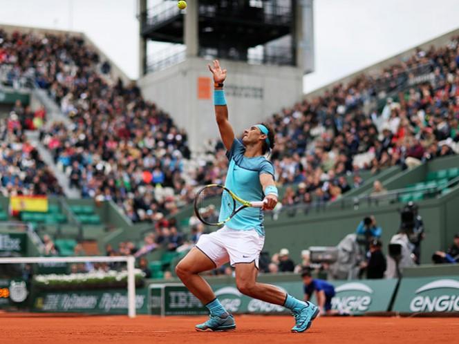 El tenista Rafael Nadal tiene su debut más fácil en Roland Garros, al vencer por triple 6-1 a Sam Groth (AP)