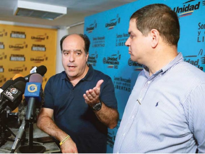 Oposición venezolana pide garantías para iniciar diálogo formal con gobierno Maduro
