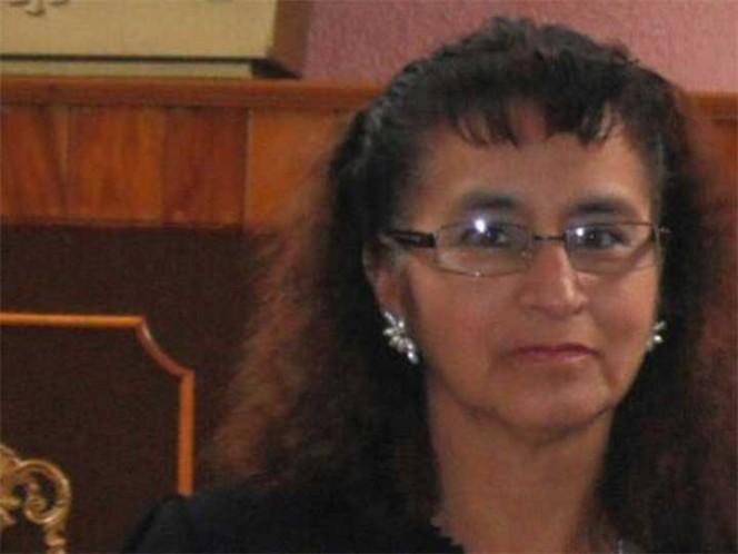 María Ortiz de 54 años, podría estar atrapada entre los escombros del edificio derrumbado de Amsterdam. Foto: Especial