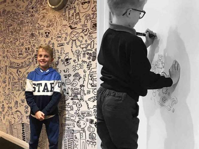 Regañan a niño por dibujar en clases lo contratan para decorar restaurante